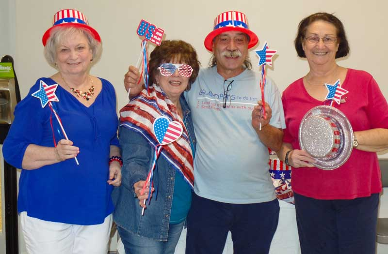 4 seniors enjoying a 4th of July party